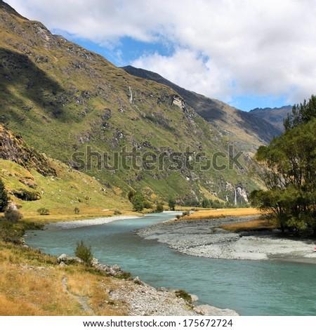 Mount Aspiring National Park in New Zealand. Glacial river. - stock photo