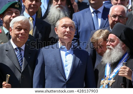 Mount Athos, Greece - May 28, 2016: Russian President Vladimir Putin, (C), President of Greece Prokopis Pavlopoulos, (L), the highest abbot of Mount Athos Pavlos (R) during his visit to Mount Athos.