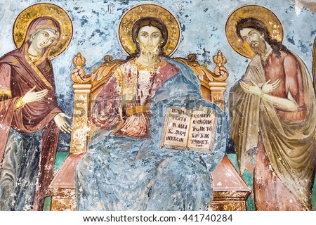 Mount Athos, Greece - May 28, 2016: Timeworn frescoes of saints on the outer side of the Church of Protaton in karyes, Mount Athos