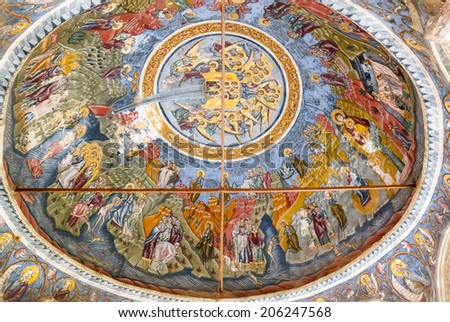 MOUNT ATHOS - JUNE 21: Fresco on roof of monastery of Holy Mount Athos in Greece on 21st June 2014. Vibrant frescoes of saints, angels and demons decorate the vaulted interior dome of a monastery. - stock photo