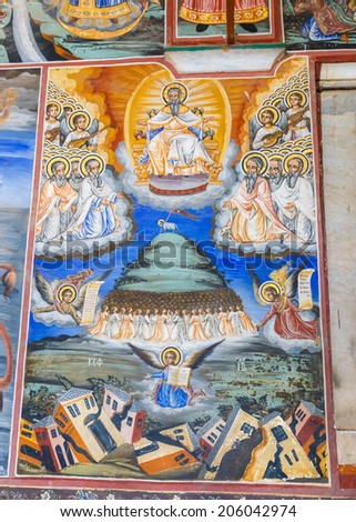 MOUNT ATHOS - JUNE 21: Fresco on walls of monastery of Holy Mount Athos in Greece on 21st June 2014. Vibrant frescoes of saints, angels and demons decorate the vaulted interior dome of a monastery. - stock photo