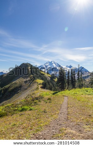 Mount Baker comes into view along Skyline Divide hiking trail  - stock photo