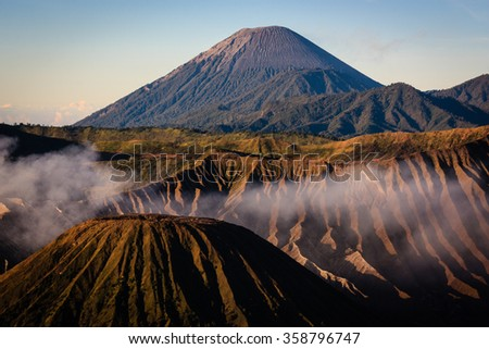 Mount Batok (in front) with Mount Semeru at background, are famous volcano in the Tengger massif, East Java, Indonesia.