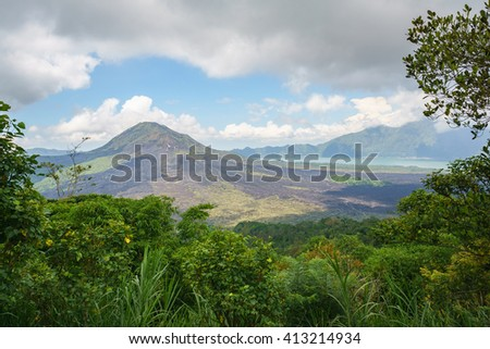 Mount Batur and its serounding, Kintamani Bali Indonesia taken during cloudy day with green foliage at foreground.