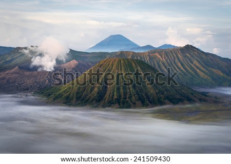Mount Bromo, Batok and Gunung Semeru at sunrise in Java, Indonesia. - stock photo