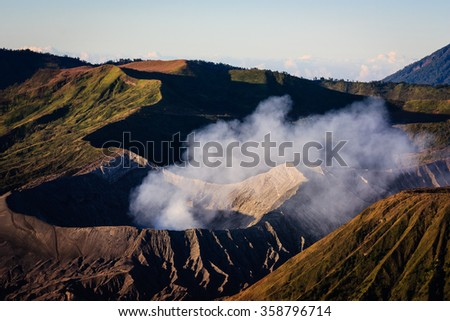 Mount Bromo is active volcano and part of Tengger massif, in East Java, Indonesia. At 2,329 meters, it is not the highest peak of the massif, but is the most well known for its larger crater. - stock photo