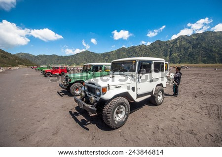 MOUNT BROMO , JAVA INDONESIA - 15 MAR 2014  :  Jeeps are waiting for their guest to comeback from crater at parking areas. - stock photo