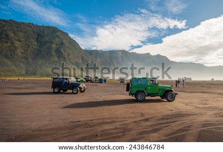 MOUNT BROMO , JAVA INDONESIA - 15 MAR 2014  :  The jeeps were running through the fields to the parking areas to see crater. - stock photo