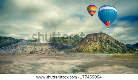Mount Bromo, Java, Indonesia with hot air travel balloon - stock photo