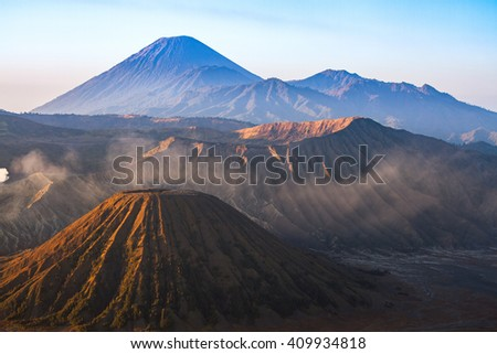Mount Bromo volcano during sunrise, the magnificent view of Mt. Bromo located in Bromo Tengger Semeru National Park, East Java, Indonesia. - stock photo