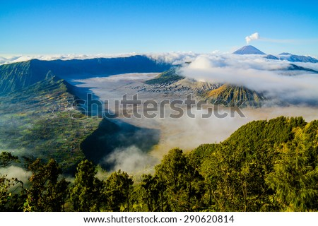 Mount Bromo volcano during sunrise, with foggy moment. The magnificent view of Mt. Bromo located in Bromo Tengger Semeru National Park, East Java, Indonesia. - stock photo