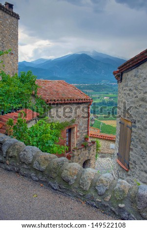 Mount Canigou in the Pyrenees from the town of Eus - stock photo