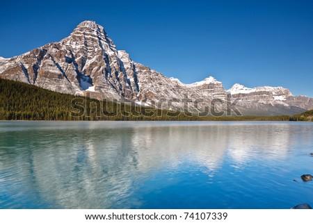 Mount Chephren and Waterfowl Lake, Icefields Parkway, Banff National Park, Alberta, Canada - stock photo