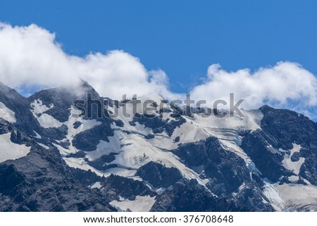 mount cook mountain tops and glaciers with clouds hanging over. Taken during summer in New Zealand.
