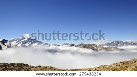 Mount Cook panoramic landscape above clouds blanket in Southern Alps, NZ. - stock photo