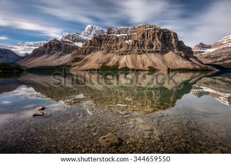 Mount Crowfoot Reflection at Bow Lake on the scenic Icefield Parkway, Banff National Park, Alberta, Canada - stock photo