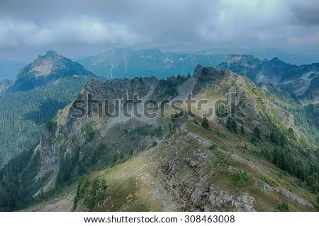 Mount Dickerman hiking trail view of scenic mountain range, amazing skyline landscape. - stock photo