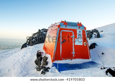 "MOUNT ELBRUS, RUSSIA - AUGUST 07, 2014: Rescue shelter ""Red Fox 5300"" on the Mount Elbrus in Russia"