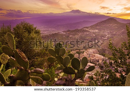 Mount Etna in Sicily seen from Taormina;  prickly pear on foreground