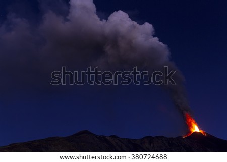 Mount Etna. Plume of ash and volcanic gases at dawn - stock photo