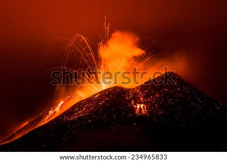 Mount Etna produces fountain of lava and ash during continued eruption.