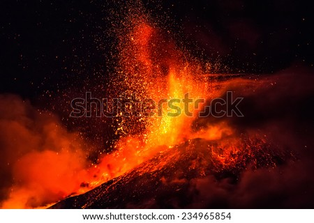 Mount Etna produces fountain of lava and ash during continued eruption. - stock photo