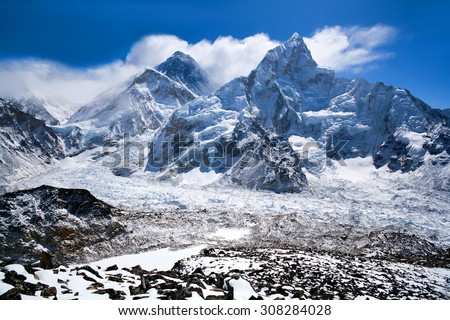 Mount Everest and Nuptse view in Sagarmatha National Park in the Nepal Himalaya. Mount Everest, also known in Nepal as Sagarmatha and in Tibet as Chomolungma, is Earth's highest mountain. - stock photo