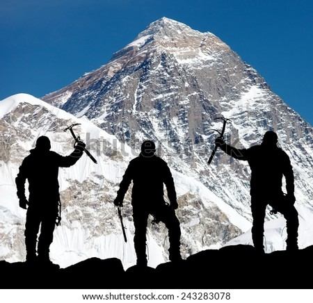 Mount Everest from Kala Patthar and silhouette of men - trek to everest base camp - Nepal  - stock photo