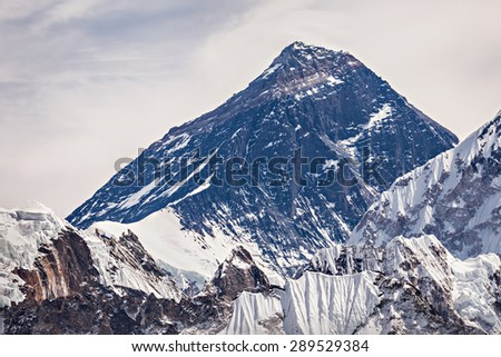 Mount Everest in Himalaya in Nepal. Everest is a highest mountain in the world. Everest peak is 8848 metres above sea level. - stock photo