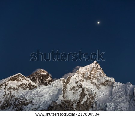 Mount Everest (8848 m), and Nuptse (7864 m) in the Moon lights (view from Kala Patthar) - Nepal, Himalayas - stock photo