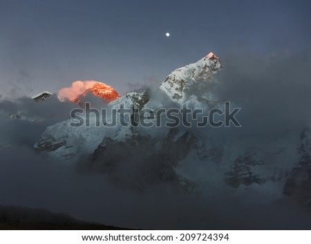 Mount Everest (8848 m) at sunset (view from slope of Kala Patthar) - Nepal, Himalayas - stock photo