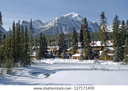 Mount Fairview, Partly Frozen over Bow River. Lake Louise, Banff National Park, Alberta, Canada - stock photo