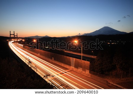 Mount Fuji and highway at sunset. - stock photo