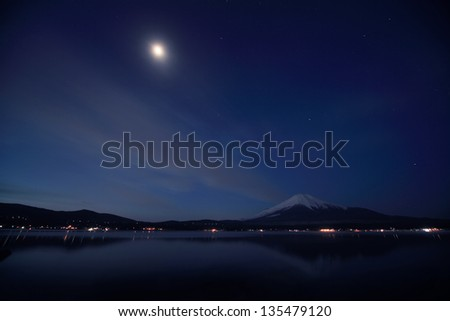 Mount Fuji and Lake Yamanaka at night. - stock photo