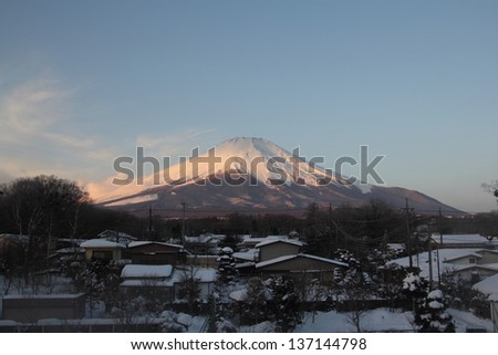 Mount Fuji and many roof in a town - stock photo