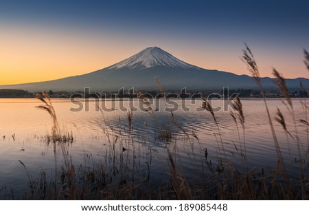 mount Fuji at dawn with peaceful lake - stock photo