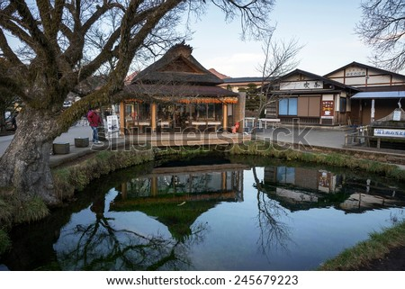 MOUNT FUJI - DECEMBER 03, 2015: Tourists visit Oshino village at the foot of Mount Fuji to view the snow-capped volcano. The water in the lakes of this village is fed by the melting snow from Mt Fuji.