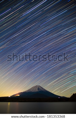 Mount Fuji, Lake Shojiko and star trails of winter stars - stock photo