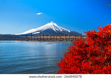 Mount Fuji reflected in Lake Yamanaka with fall colors, Japan. - stock photo