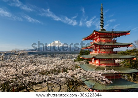 Mount Fuji with a red pagoda in spring season with cherry blossoms, Japan - stock photo