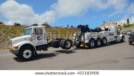 Mount Hood, Oregon - July 19, 2016: a heavy-duty tow truck pulls another truck