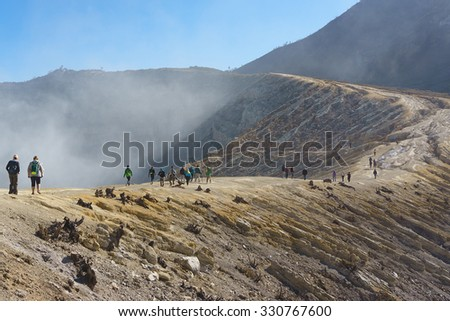Mount Ijen Indonesia-Oct 16, 2015:Visitor walking at Mount Ijen crater ridge on Oct 16, 2015.Mount Ijen located in Banyuwangi is one of most visited active volcano in East Java. - stock photo