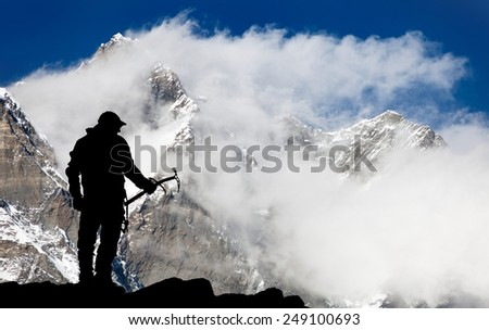 Mount Lhotse and silhouette of man wihh ice axe - way to everest base camp - Nepal