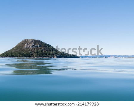 Mount Maunganui and harbor entrance from sea, New Zealand. - stock photo