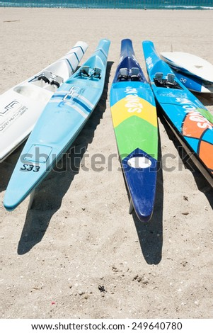 MOUNT MAUNGANUI, NEW ZEALAND-JANUARY 22;Surf skis on beach ready for event  on January 22, 2015 at Mount Maunganui, New Zealand. Surf championships are being held here. - stock photo