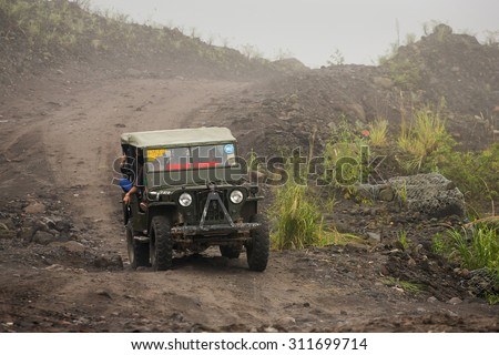 Mount Merapi , Java Indonesia - 15 April 2015 : Jeeps with tourists coming back from a ride around Merapi volcano. - stock photo
