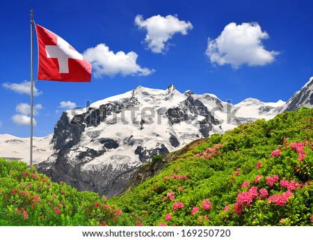 Mount Monte Rosa with Swiss flag - Swiss Alps  - stock photo