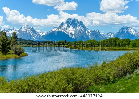 Mount Moran at Oxbow Bend of Snake River - Spring clouds passing over snow covered Mount Moran at Oxbow Bend of Snake River in Grand Teton National Park, Wyoming, USA. - stock photo