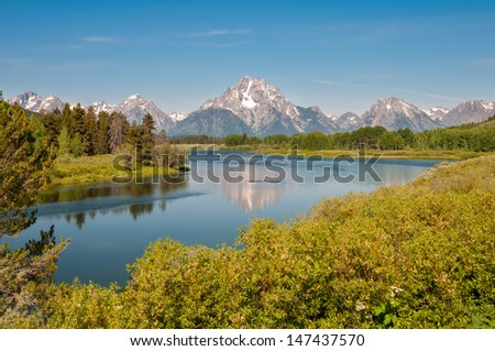 Mount Moran vista from Oxbow Bend at Grand Teton National Park, Wyoming. - stock photo