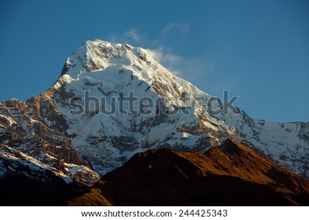 Mount peak Annapurna South At Sunrise In Himalayas